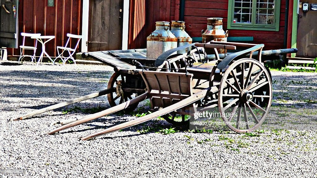 Milk Canisters On Wooden Cart : Stock Photo