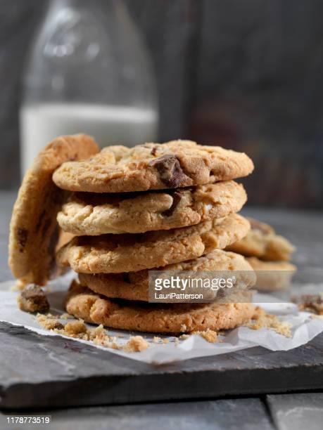 milk chocolate, macadamia nut cookies and milk - cookie stock pictures, royalty-free photos & images