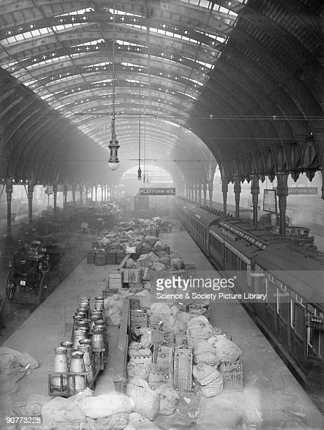 Milk churns and mail sacks on a platform at the Great Western Railway's Paddington Station, Christmas 1908. In the early 1900s the amount of milk...