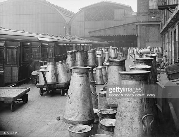 Milk churns being unloaded from a train at Paddington station The milk had come from stations between London and Plymouth In the early 20th century...