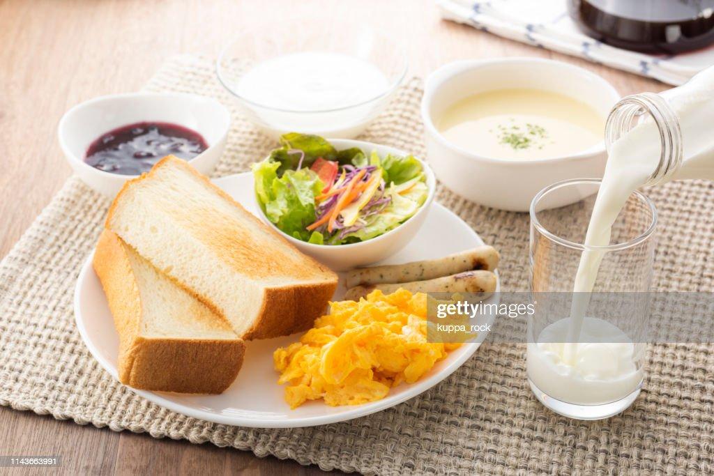 Milk for breakfast : Stock Photo