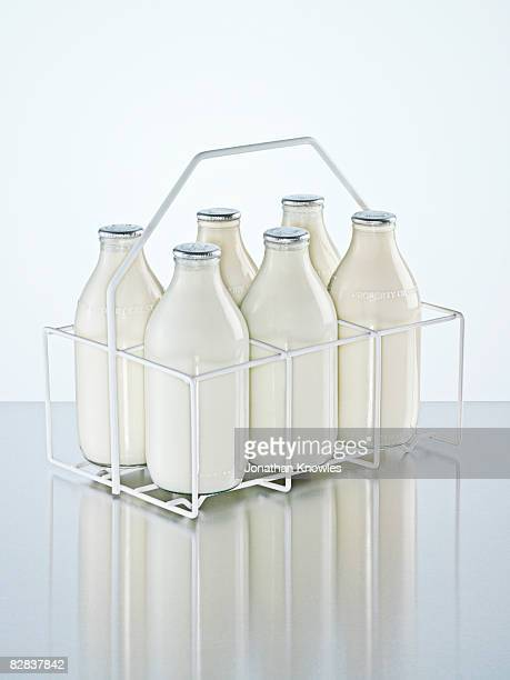 milk holder with milk bottles - milk bottle stock pictures, royalty-free photos & images