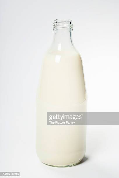 Milk in a glass bottle over white