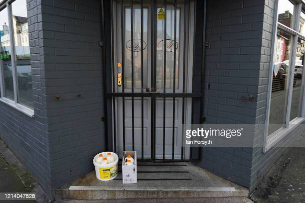 Milk is left outside an Italian restaurant entrance in Saltburn By The Sea as the UK adjusts to life under the Coronavirus pandemic on March 22 2020...