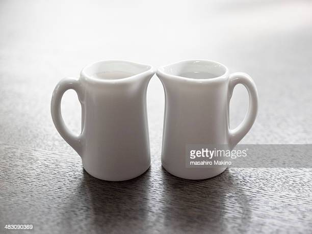 milk pitchers - pitcher stock pictures, royalty-free photos & images