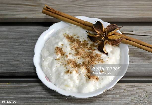 Milk rice pudding in pot with cinnamon