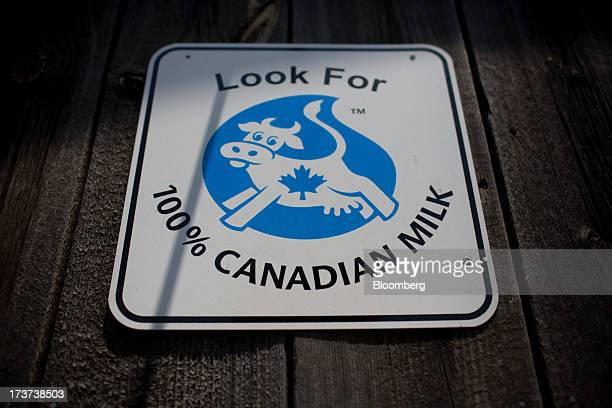 A milk sign hangs at the Loewith dairy farm in Lynden Ontario Canada on Tuesday July 16 2013 The National Milk Producers Federations Board of...