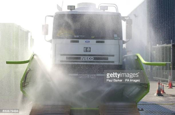 A milk tanker goes through a high pressure wash before being disinfected at the Zenith Milk distribution centre near Thirsk North Yorkshire as part...