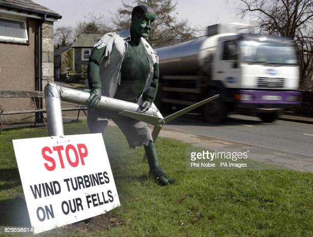 A milk tanker passes a caricature of the Incredible Hulk destroying a wind turbine An inquiry began today into plans to build Europe's largest wind...