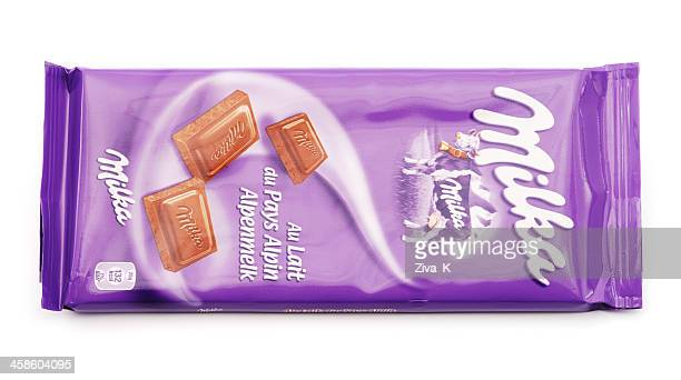 milka chocolate - candy wrapper stock photos and pictures