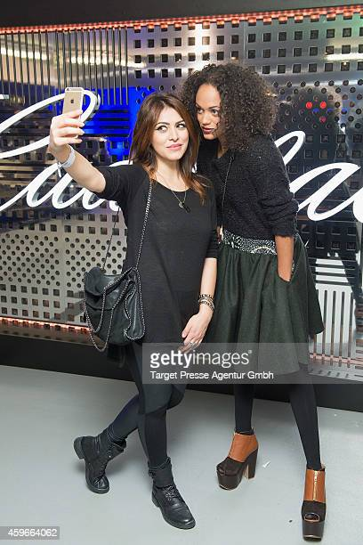 Milka Loff Fernandes and guest attend the Cadillac Experience Grand Opening on November 27 2014 in Berlin Germany
