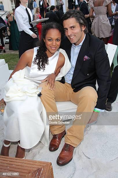 Milka Loff Fernandes and her husband Robert Irschara attend the Raffaello Summer Day 2014 at Kronprinzenpalais on June 21 2014 in Berlin Germany
