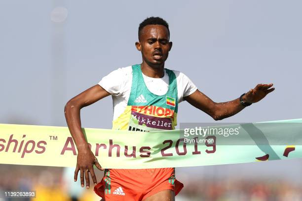 Milkesa Mengesha of Ethiopia crosses the line to win the Men's U20 Final during the IAAF World Athletics Cross Country Championships on March 30 2019...