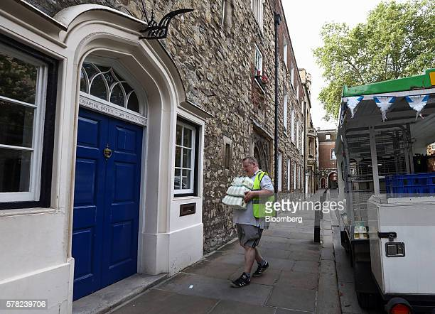 A milkman delivers cartons of milk to the door of the Chapter office in Dean's Yard behind Westminster Abbey in London UK on Wednesday July 20 2016...