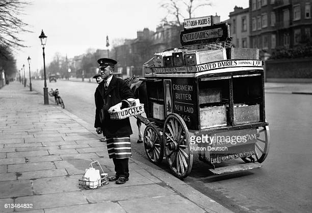 A milkman from the United Dairies Limited delivers milk and other groceries using a horse and wagon for transportation