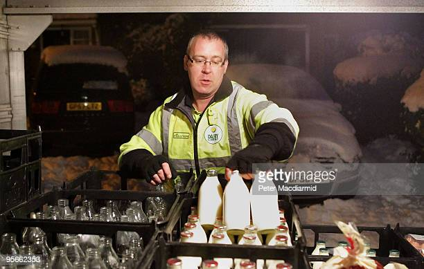 Milkman Guy Whittaker delivers milk in the snow on January 9 2010 in Guildford England The United Kingdom continues to suffer from extreme cold...