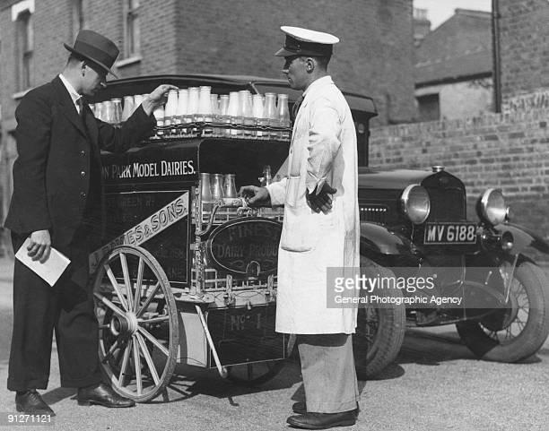 A milkman having his float inspected circa 1935