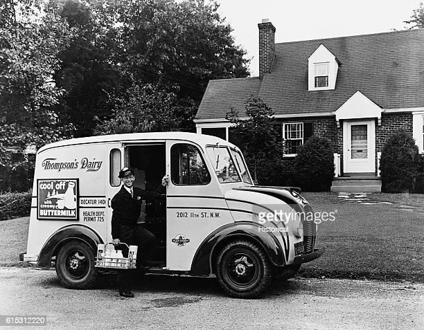 Milkman in Doorway of Milk Truck