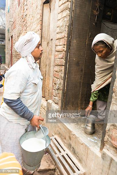 milkman in the morning in india - milkman stock photos and pictures