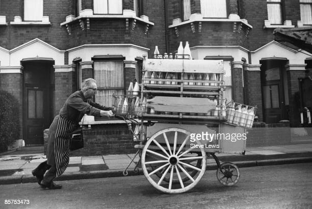A milkman on his rounds in the East End of London 1960s