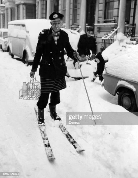 A Milkmen delivers milk using skies on a snowy street in London December 311962