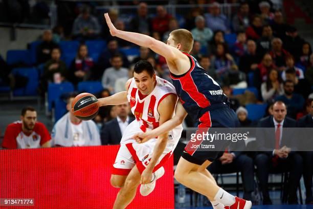Milko Bjelica #51 of Crvena Zvezda mts Belgrade competes with Rinalds Malmanis #8 of Baskonia Vitoria Gasteiz during the 2017/2018 Turkish Airlines...