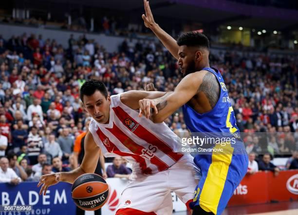Milko Bjelica of Crvena Zvezda in action against Jonah Bolden of Maccabi during the 2017/2018 Turkish Airlines EuroLeague Regular Season game between...