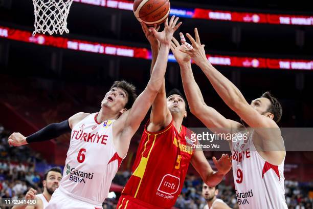 Milko Bjelica of Montenegro competes for the ball with Cedi Osman and Semih Erden of Turkey during the classification round of 2019 FIBA World Cup...