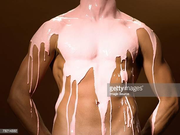 Milkshake dripping down a mans torso