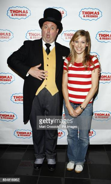 Milkshake presenter Naomi Wilkinson poses with a man dressed in costume as the character of the Fat Controller from the Thomas the Tank Engine...