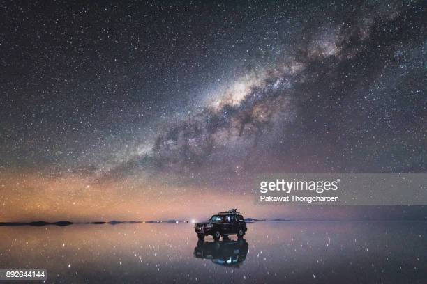 milky way across uyuni, bolivia - milky way stock pictures, royalty-free photos & images