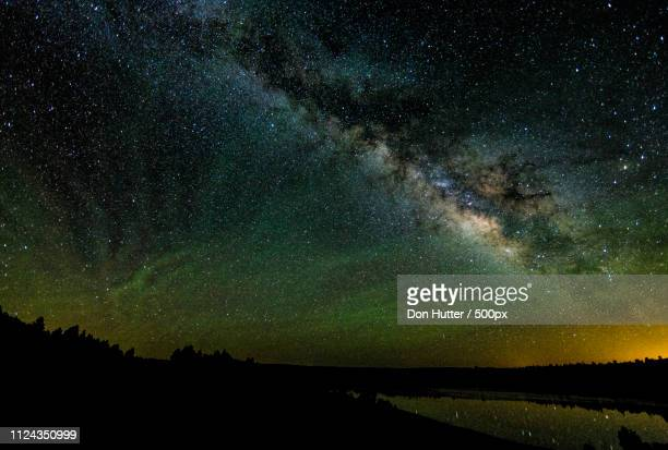 milky way & airglow - flagpole stock pictures, royalty-free photos & images