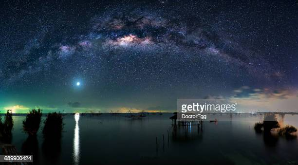 milky way and big fishing nets in phatthalung lake, pakpra, thailand - venus planet stock pictures, royalty-free photos & images