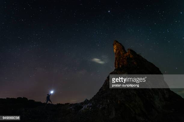 Milky way and torch man on a hill