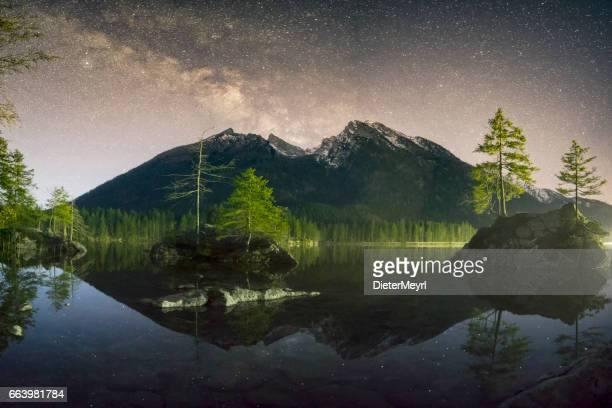 milky way at hintersee lake in alps, germany - berchtesgaden national park stock photos and pictures