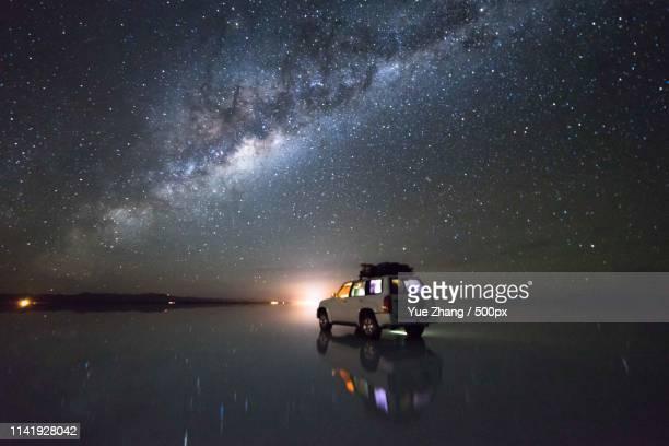 milky way at uyuni salt flat, bolivia - salt flat stock pictures, royalty-free photos & images