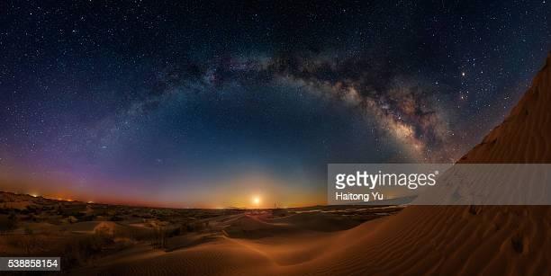 Milky way bridge over huge sand dunes