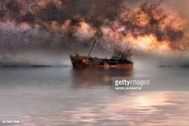 milky way galaxy and shipwreck.