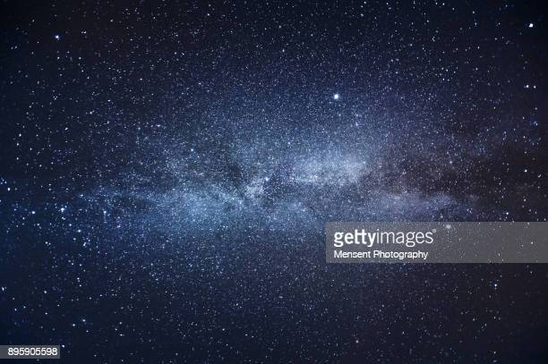 milky way galaxy and stars in the night sky - solar system stock pictures, royalty-free photos & images