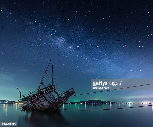 Milky Way Galaxy over a boat