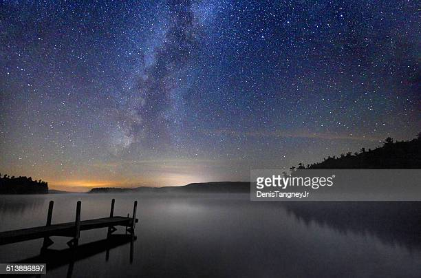milky way  galaxy over a calm lake in new hampshire - new hampshire stock pictures, royalty-free photos & images