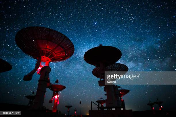 milky way galaxy over the satellite receiving station - astrophysics stock pictures, royalty-free photos & images