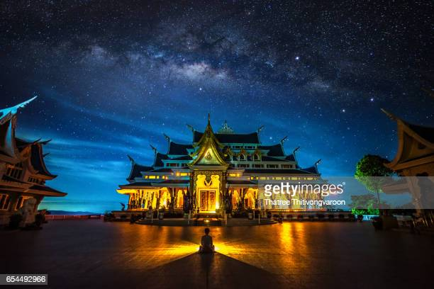 Milky way galaxy with Bright Stars and space dust of Thai Temple ,the northeast of Thailand : Wat Pa Phu Kon