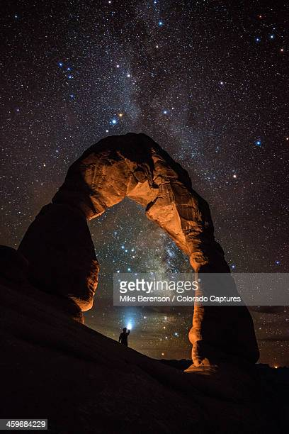 milky way illumination at delicate arch - moab utah stock pictures, royalty-free photos & images