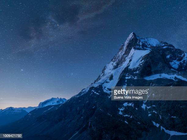 milky way in a starry night in the mountains - zermatt stock pictures, royalty-free photos & images