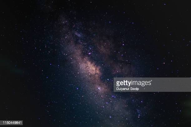 milky way in the sky in thailand. - beroemdheden stockfoto's en -beelden