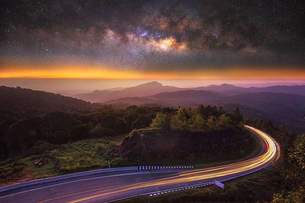 milky way on the top mountain and road at front in intanon mountain , most tallest mountain in chiangmai , thailand - free images without copyright stock pictures, royalty-free photos & images