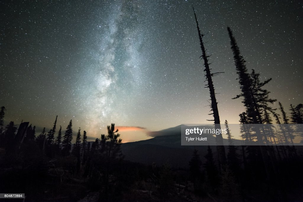 Milky way over a shrouded Mt. Hood and night sky with stars : Stock Photo