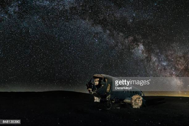 milky way over abandoned plane on southern icelandic beach close to vik - iceland - fuselage stock photos and pictures