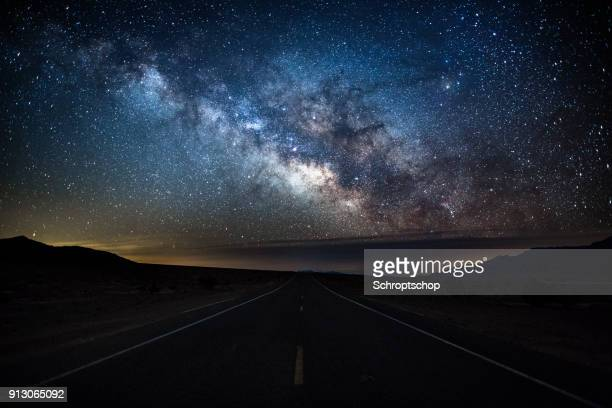 milky way over country road - death valley, usa - great basin stock pictures, royalty-free photos & images